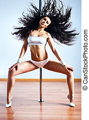 Young sexy woman shaking hair - Young sexy pole dance woman...