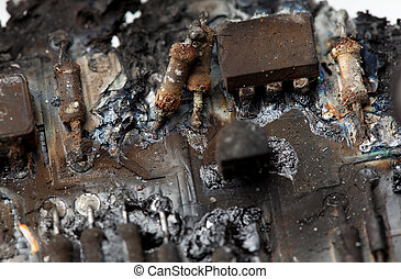 Burnt circuit board. - Close-up of burnt components on a...