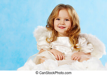 Little angel - Happy little girl with smile wearing angel...