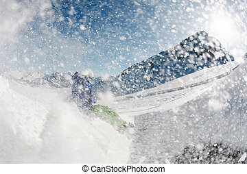 Snowboarding - Photo of snowboarder over snowdrift going in...