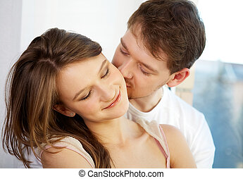 Enjoying - Pretty woman has pleasure from male kisses