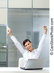 Success - Image of young businesswoman raised arms at...