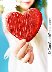 Wooden heart  - Close-up of girl holding wooden a red heart