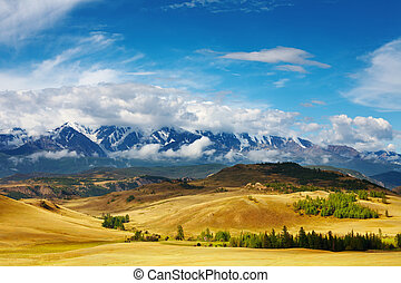 Mountain landscape - Landscape with snowy mountains and blue...