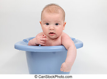 Three month old baby in a bathtub
