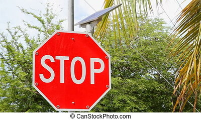 Solar Powered Stop Sign - Small lights around a solar...