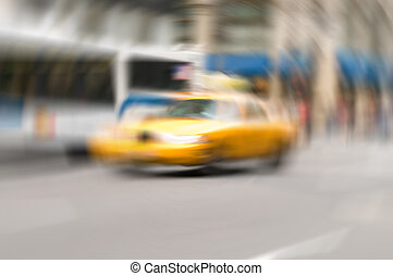 Famous New York yellow taxi cabs - intentional blur