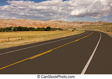 Empty highway in desert, Wyoming, USA