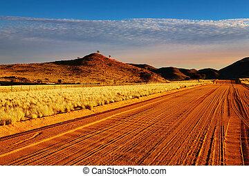 Road in Kalahari Desert at sunset, Namibia