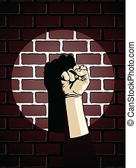 Fist against brick wall - Defiant fist in spotlight against...