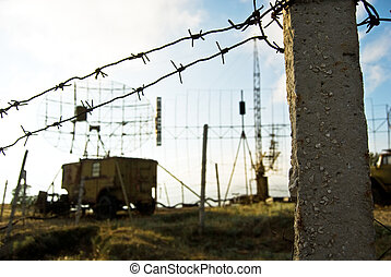old military base - close-up fence of the old Soviet Russian...