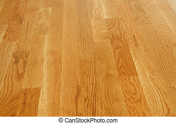 Polished Hardwood Floor - A clean and polished hardwood...