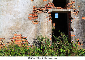 brick wall of the old destroyed building