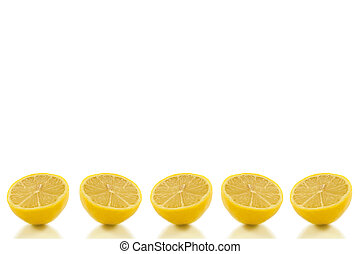 Background lemon row - Five small lemon halves arranged in a...