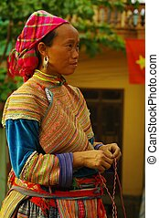Flowered Hmong Woman - Hmong woman back from the market of...