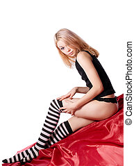 Young girl dress striped socks on red