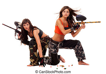 Girls playing paintball - Two young beautiful girls posing...