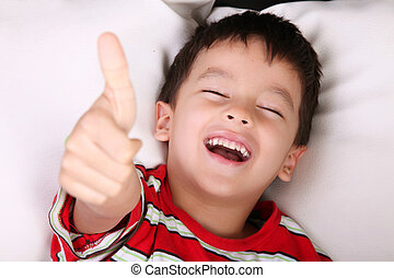 Expressing positivity - Child smiling and expressing...