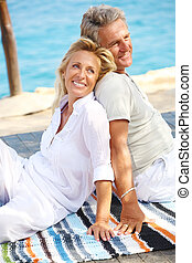 Happy mature couple smiling and embracing outdoors