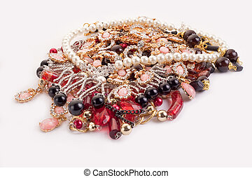 A pile of colored jewellery on white background