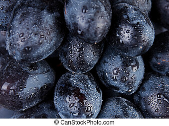 Grape fruit - Fresh blue grape fruit background in water...