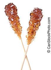 Brown amber sugar crystal on wood stick