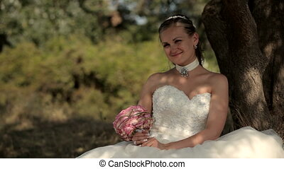 Bride sat down to rest - A beautiful young girl sitting in...