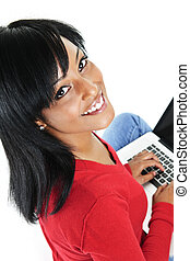 Young black woman using laptop computer - Smiling black...