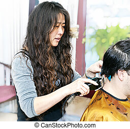 Hairstylist working - Hairdresser cutting hair in her salon...