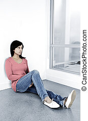 Depressed woman sitting on the floor - Depressed black woman...