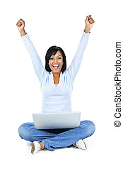 Successful young woman with computer - Happy black woman...