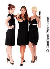 Three women black firearms