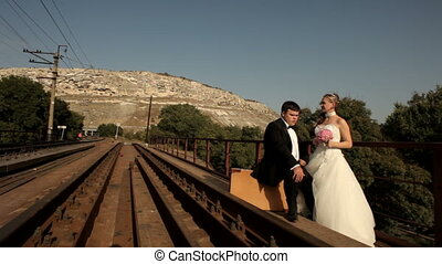 Tired of waiting - The newlyweds are waiting for a train and...