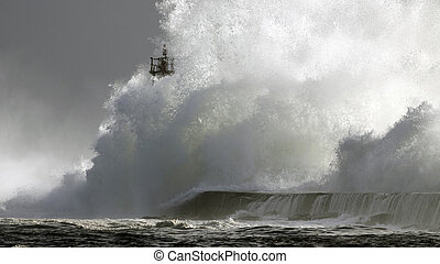 Perfect storm, the wave - Big wave against lighthouse in the...