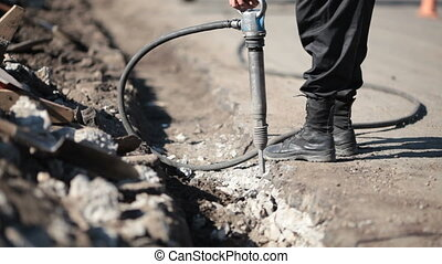 Worker using a jackhammer