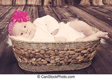 Vintage baby with flower