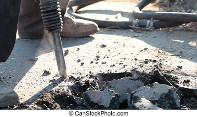Worker using a jackhammer