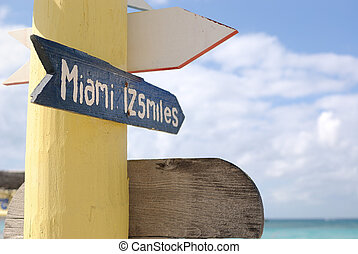 Miami Sign - Sign pointing 125 miles to Miami from a...