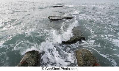 Sea 12 - Waves landing on stone coast.