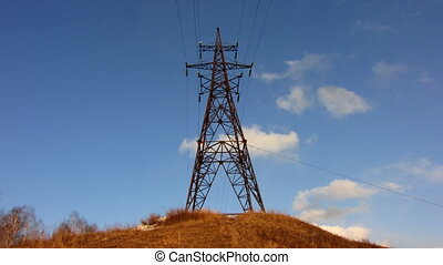 Power Lines 10 - Time-lapse blue sky electricity pylon white...