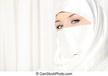 The eyes have it - Arabic woman wearing white Hijab on white...