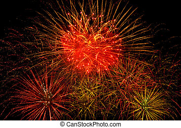 fireworks - Bright festive fireworks against a black...