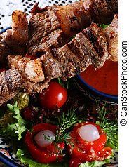 Fried kebab meat with red pepper