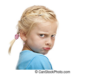 Young girl looks angry and offended in camera. Isolated on...