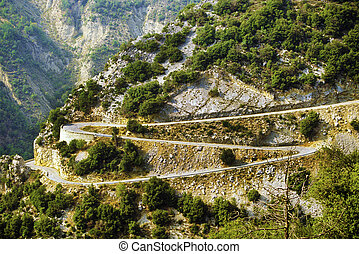 Winding road - winding road with switchbacks in the Alps
