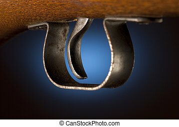 Gun trigger - Trigger of a rifle back lit by blue spot
