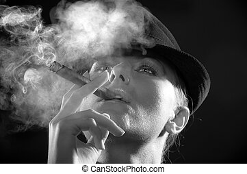 woman smoking cigar - Backlight image of girl in the hat...