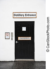 Distillery entrance with a note saying 'access forbidden to...