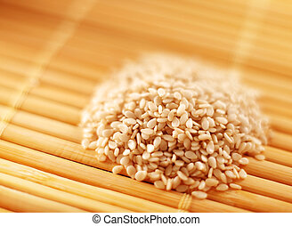 Sesame seed heap closeup on yellow napkin