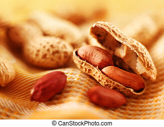 Peanut with shell - Brown peanut nut with shell on yellow
